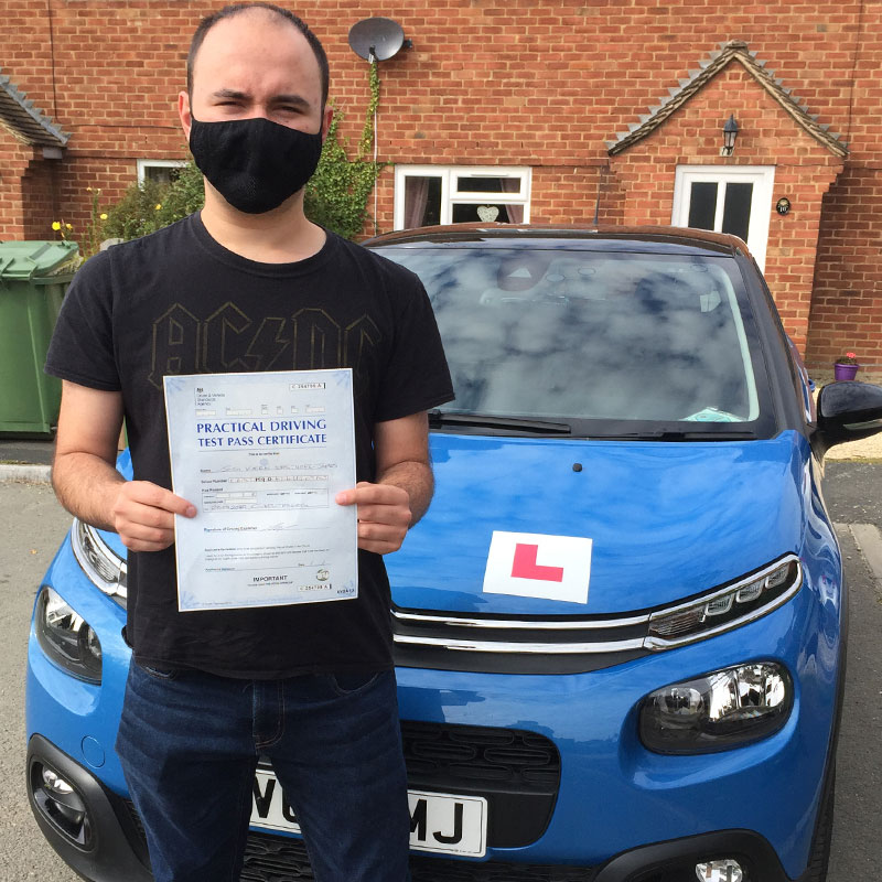 Joshua Easthope driving test pass with covid safety mask in September 2020.